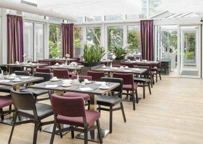 Mercure Hotel Dortmund Centrum Wintergarten Tische Seitlich Detail